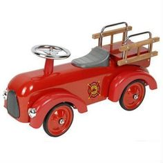 Dexton Classic Fire Engine Racer - Red - DX-20750 $100 Be the little hero that saves the day and race to the scene with their very own classic red fire engine racer! This little car encourages outdoor play and develops gross motor skills. It comes with a full metal body, wooden ladders on ladder racks, custom decal, chrome steering wheels, plastic seats and steel wheels with rubber tires and plastic fenders. For ages 1.5 to 3 years of age