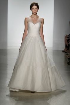 Classic Just because it's hot outside doesn't mean you have to wear a gown fit for the beach. If you want to wear a ballgown, go for it! Our tip: Choose a style in a lightweight fabric like tulle, chiffon or organza, that features minimal heavy beading.
