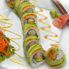 Dragon Roll • Eel, crab, and cucumber inside. Avocado outside.