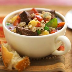 "BEEF BARLEY SOUP 12ounces beef stew meat, into 1"" cubes  1T oil 4 cans beef broth1 large onion, chopped 1 stalk celery chopped   1t dry oregano or basil, crushed1/4t blk pepper 2cloves garlic, minced1bay leaf  1c frozen mix vegetables14 1/2oz diced tomatoes, undrained1c 1/2"" slices peeled parsnip, or 1/2"" cubes peeled potato  2/3c barley   Brown beef in hot oil. Drain off fat. In 5-6-quart slow cooker combine beef and rest of ingredients. Cover on low for 8-10 hrs or on high for 4-5 hrs."