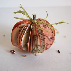 Ways to drive your librarian mother insane:  Part II      Pumpkins out of old books!  Used books are everywhere for super cheap...now I have a reason to actually buy some! :)