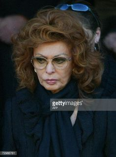 Italian actress Sophia Loren leaves the San Martin church in Magenta, near Milan, at the end of her husband Carlo Ponti's funeral, 12 January 2007. Carlo Ponti, a producer who was known both for classic films such as 'Doctor Zhivago' and for his long marriage to the film star Sophia Loren, died early 10 January at a hospital in Geneva. He was 94. AFP PHOTO / GIUSEPPE CACACE