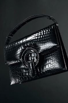 Black Crocodile Mini Handbag from the Darby Scott Grommet Collection. Grommet detail has black onyx jeweled inlay and exotic trim. An adjustable/removable self-strap is included. Clutch has a magnetic closure and interior ticket pocket.