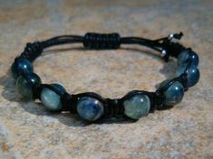"""Blue Kyanite Healing Energy Bracelet - """"This is a high crystal energy stone, and is also a third eye chakra stone. This crystal is wonderful to use on the throat chakra as it will open the chakra, creating better communication and self expression. Its impact when communicating, assists you to speak your personal truth.""""  http://zenjewelry.mysticnaturals.com/blue-kyanite-healing-bracelet/"""