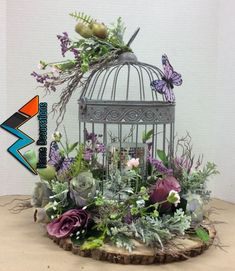 Floral design I made using wire bird cage glued to foam that was glued to log slab. Added a painted thin wood circle inside cage to cover glue. Added LED candle with mirror tiles inside cage. Bird Cage Centerpiece, Wood Circles, Deco Floral, Floral Foam, Vintage Floral, Deco Table, Silk Flowers, Bird Houses, Wedding Centerpieces
