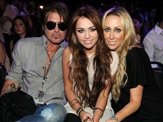 "Separation Anxiety  Billy Ray Cyrus filed for divorce from his wife Tish Cyrus in late October 2010. Within a few days, the media reported rumors of an affair between Tish and rocker Bret Michaels, but Miley's mom and Michaels both denied the allegations. In February, GQ released an interview where Billy Ray blamed Hannah Montana for ""destroying"" his family and he was quoted saying that he wished he could ""erase it all in a second."""