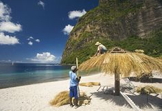 Two men thatching palapa on beach, Jalousie Plantation, Saint Lucia, Caribbean (© Macduff Everton/Corbis)