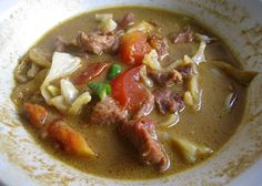 Tongseng, a Javanese spicy and rather sweet goat meat soup. Specialty of Solo (Surakarta), Central Java, Indonesia.
