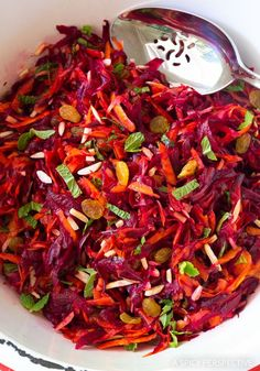 Crunchy Beet Carrot Slaw - A Spicy Perspective-Crunchy Beet Carrot Slaw Recipe - A light vegetarian salad with massive flavor. Only 5 base ingredients, and a simple dressing, yet huge wow-factor! Beetroot And Carrot Salad, Carrot Slaw, Carrot Salad Recipes, Slaw Recipes, Chili Recipes, Vegetable Recipes, Vegetarian Recipes, Cooking Recipes, Healthy Recipes