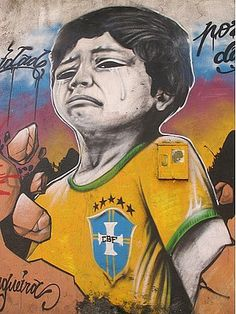 """Brazilian graffiti artists shows the pain of the terror caused by the military police that is trying to """"clean up"""" Brazil before the world tournament soccer starts."""