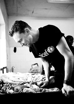 Tom Hiddleston: I can't decide if the look on his face or the look on the baby's face is more beautiful.