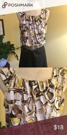 Dana Buchman Sleeveless Top Tones of brown and yellow on Ivory background. Knit top by Dana Buchman. Size Medium. Soft gathers at round neckline. Excellent condition. Dana Buchman Tops Tank Tops