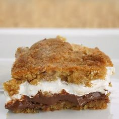 Smores bars...layer of cookie dough, layer of chocolate, layer of marshmallow fluff and final layer of cookie dough...yes! via divaj15
