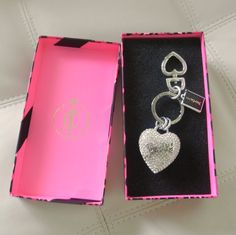 Keep your keys close to the heart with this adorable key chain from juicy couture. Crafted from silver-tone mixed metal with a rhinestone-embellished heart, it comes ready to wrap in a custom gift box. Item Details: Juicy couture key fob. Silver-tone hardware. Rhinestone-embellished heart with si...