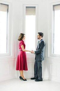 Ildiko Neer YOUNG RETRO COUPLE HOLDING HANDS BY WINDOW