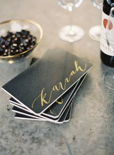 other ideas for bridesmaids gifts // calligraphy decals on black notebooks.