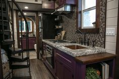 This is a Tudor-style Fairytale tiny house on wheels built by Tiny Heirloom and featured on a recent episode of Tiny Luxury on HGTV's DIY Network and you're welcome to come check it out and learn more about it inside! Tiny House Swoon, Best Tiny House, Tiny House Living, Tiny House On Wheels, Tiny House Layout, Tiny House Design, House Layouts, Tudor Kitchen, Tudor House