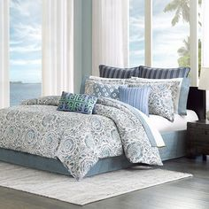 Refresh your master suite with this lovely comforter set, showcasing a delightful floral pattern for a touch of botanical appeal.