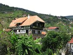 La Colonia Tovar, Venezuela.  A German village, founded in 1843, in the mountains of Venezuela.  The european style buildings seem surreal next to palm trees.  Definitely worth a visit.  An oasis of calm after busy Caracas.