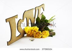 Yellow roses engagement ring and love signs