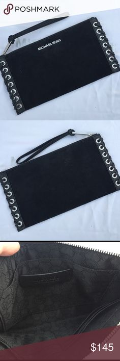 Michael Kors grommets Hippie Clutch Michael Kors Hippie Clutch Color:Black/Hardware silver Suede leather Card Holder inside  Measurements: 10.5Lx5.5Hx..5D No tags or dust bag This is a USED item but well taken care of. Michael Kors Bags Clutches & Wristlets