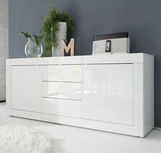 Buy Contemporary furniture in modern furniture designs, complete range of affordable cheap modern furniture for Home and office, including modern bedroom furniture, modern dining room furniture, contemporary living room furniture and office furniture White Gloss Bedroom Furniture, Contemporary Living Room Furniture, Door Furniture, Dining Room Furniture, Modern Furniture, Dining Rooms, Furniture Ideas, Dining Room Sideboard, Dining Buffet