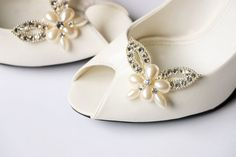 This listing is for A PAIR of shoe clips. These lovely shoe clips are just the right size to add a touch of sparkle and elegance to your wedding shoes!They can even be worn for any occasion in variety of ways on your shoes. These hand made shoe clips, are made with the finest quality pearls and rhinestones!  ********INTERNATIONAL BUYERS******** Please read the International shipment policies before placing the order! To see more of our gorgeous bridal shoe clips and bridal flip flops, please ... Bridal Sandals, Bridal Shoes, Wedding Shoes, Bridesmaid Flip Flops, Bridal Flip Flops, Jeweled Shoes, Sparkly Shoes, Rhinestone Shoes, Crystal Shoes
