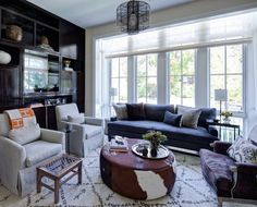 Andrea Goldman Designs | Styled BLG. I'll stop, but look at the pop of orange in a room that is similar to yours.