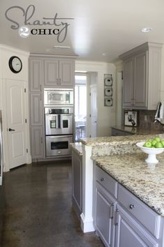 Article about painting kitchen cabinets. grey painted cabinets but look at her floor dannie Kitchen Cabinets Grey And White, Painted Kitchen Island, Grey Kitchen Floor, Light Grey Kitchens, Stained Kitchen Cabinets, Paint For Kitchen Walls, Kitchen Cabinets Decor, Kitchen Cabinet Colors, Grey Cabinets