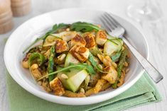 Asparagus and halloumi pasta with an unbelievably delicious smoky tomato pesto, made with Greek yogurt so it's extra creamy! A great easy vegetarian dinner.