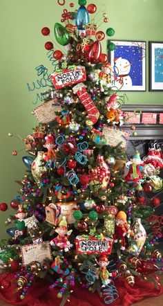 """What an Adorable Christmas Tree! Love the Oversized Christmas Bulbsused as a Topper and the North Pole Signs! Postmark Christmas Tree Decorations - what a terrifying christmas tree! Beautiful Christmas Trees, Colorful Christmas Tree, Christmas Tree Themes, Noel Christmas, Holiday Tree, Winter Christmas, Christmas Tree Decorations, Holiday Decor, Xmas Trees"