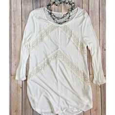"Sheer Ivory and Lace top Beautiful sheer Ivory top with lace cutouts on the front of the top. Sheer top, will look great with a tank top underneath. 3/4"" sleeve. Keep cool in the warm weather with the soft and thin material. 100% rayon. Size M. Length of top is 30"". Tops"