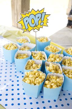 [superhero party] I actually designed the superhero invitation with one of my sons in mind. This is a pic of some of the snacks for his party at a local park. I love the polka dot table runner and pops of yellow, cyan and white.