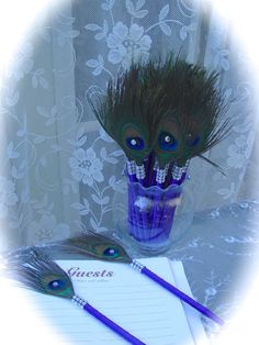 Hey, I found this really awesome Etsy listing at https://www.etsy.com/listing/179316961/ready-to-ship-purple-peacock-feather-pen