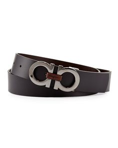 "Men's calfskin belt reverses to black or brown. Silvertone double Gancini buckle. Engraved wooden logo at center. Five hole adjustment. Approx. 1 3/8""W. Made in Italy."