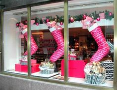 Fauchon | Christmas Window Display Use entire window, oversizer stocking and create faux mantle
