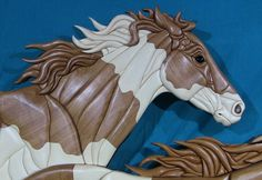 """Kathy Wise's Intarsia Mural """"Wild Horses"""" is displayed at the B.O.B. in Grand Rapids, MI, for Art Prize 2014. VOTE 56201"""