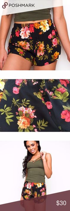 "Black Floral Shorts Gorgouse  lightweight, chiffon fabric with minimal stretch in a multi-colored floral print. High-waist. Elastic waistband for a custom fit. Dolphin hem. Unlined, finished hem. *100% Polyester *24"" Waist; 9.5"" Side; 11"" Front; 13"" Back; 2"" Inseam *Model is wearing size small *Hand wash cold; hang dry perfect pair of lightweight shorts for the summer. Black with a sweet rose flower pattern. Happy Organics Boutique Shorts"