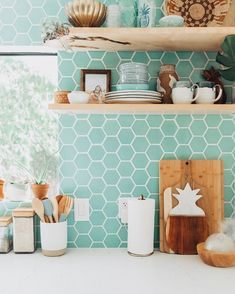 Fun back splash! Creative! The floating shelves add rad character as well! Shop our shelves on our website!