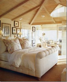 The master suite is upstairs and basks in the sun-streaked palette.  Wall-to-wall sea grass, creamy walls, and whitewashed ceilings allow the view of the pacific to be the main focus.