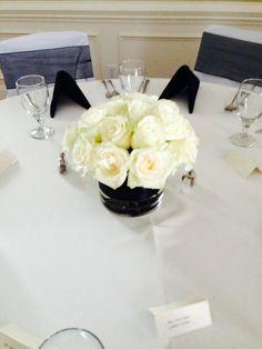 White roses with black ribbon