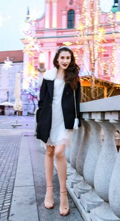 Fashion Blogger Veronika Lipar of Brunette from Wall Street wearing white sequinned dress, short loose black and white coat from Escada, rose gold metallic in high-shine glass sandals from Stuart Weitzman, blue glove, white shoulder bag and tiara for NYS Eve Party