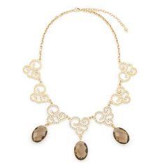 COLLAR RAFAT. Collar con preciosas piedras brillantes en tonos marrón y pequeñas incrustaciones de relucientes cristales en la fina montura, elaborado en 4 baños de oro de 18 Kt.