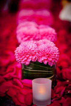 Hot pink wedding flower centerpieces, photo by Twin Lens