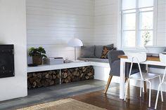 window bench + dining space + log storage via  Sköna hem