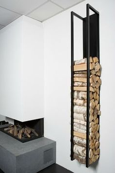 A modern fireplace. Wood storage like this could be paired with my other fireplace designs - even outdoors. But this version works well with a modern Scandinavian style fireplace Wood Supply, Firewood Storage, Firewood Rack, Fireplace Design, Fireplace Ideas, Fireplace Glass, Modern Fireplace, Fireplace Doors, Backyard Fireplace