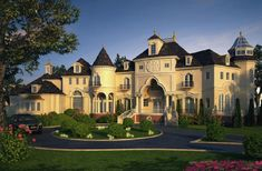 French chateau style manor house...not completely sold on the architecture, but I love, love, love the driveway and landscaping.