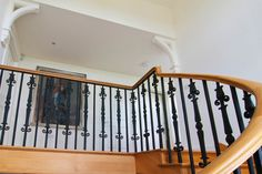 www.stockwell-ltd.co.uk   Curved, cut-stringer, american white oak staircase with continuous handrail and bespoke wrought-iron spindles. Wrought Iron Spindles, Staircase Spindles, Timber Staircase, Wooden Staircases, Staircase Design, Loft Conversion Stairs, Stairs Cladding, Staircase Manufacturers, Bespoke Staircases