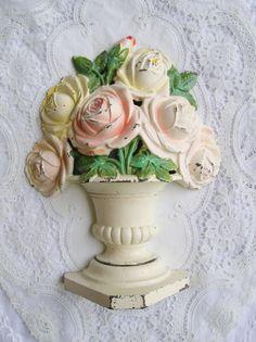 Vintage cast iron roses Hubley doorstop.