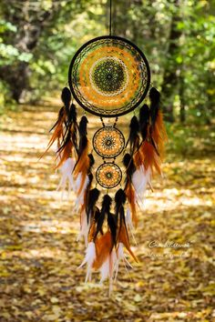 Large black, orange and white feathers dreamcatcher. Autumn wall hanging decor for bedroom. Modern g